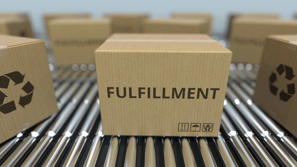 A box that says fulfillment and is on a conveyor.